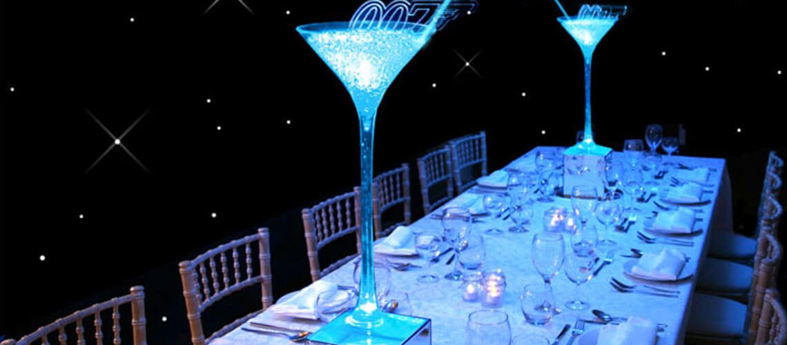 Martini glass 007 themed table centre